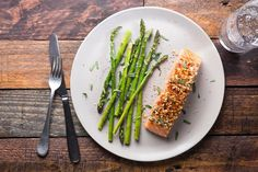 Gently baking salmon in a low-temperature oven ensures a moist and succulent fillet and only takes about 15 minutes. The asparagus cooks on the same baking sheet, making clean-up a breeze.