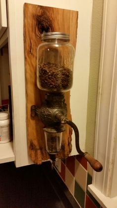 Crystal Arcade coffee grinder on barn wood