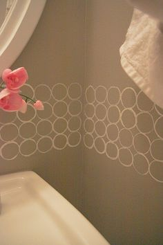 Nice simple design on the gray bathroom wall... http://www.bathroom-paint.net/bathroom-paint-color.php