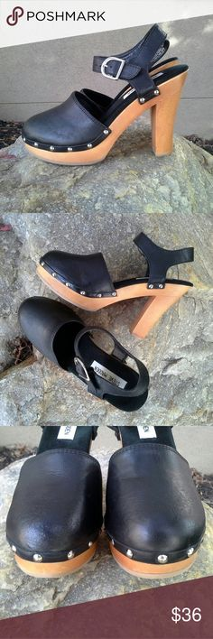 """STEVE MADDEN Fargo Wood Platforms I'm a total fan of this effortless, easy style. Great with boho dresses and denim anything. Adjustable ankle strap. Black leather uppers. Light wood heels. Silver tone hardware and studs. Made in Brazil. Heel height 4"""" side center of heel / 4.5"""" very back of heel, platform 1.25"""". A little bruise on the right shoe's heel up at the top, but it's not one of those splintering, coming apart ones, it's nice and stable, and not deep. Other than that, almost new…"""