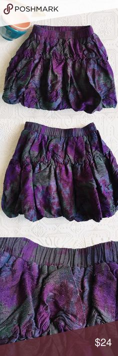 Peek Girls' Silk Bubble Dress This Peek silk bubble skirt in a purple and turquoise ikat print is a showstopper! Outer fabric is 100% silk, lining is jersey. Size 4-5. In gently used condition. Some pilling, which is shown in the pictures, but it does not take away from the beauty of the skirt. Elasticized waist. Peek Bottoms Skirts