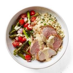 Eating Well (March/April 2016): Roast Pork, Asparagus & Cherry Tomato Bowl - In this healthy bowl-dinner recipe, hummus may seem like an unconventional dressing ingredient, but here we thin it with some hot water to make a rich, creamy drizzle.