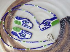 Items similar to Seahawks - Hawks kelly green and dark blue hand beaded delica necklace earring set 4 the fan in you on Etsy Brick Stitch Earrings, Seed Bead Earrings, Star Earrings, Loom Patterns, Beading Patterns, Beading Ideas, Bead Jewellery, Beaded Jewelry, Beaded Earrings Patterns