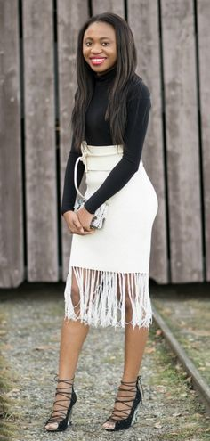 Alaska fashion blogger: fringe tassel skirt, beaded structured clutch and lace up wedge