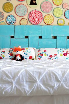 Little Bit Funky: project headboard. Like the fabric circles. Would be  perfect in