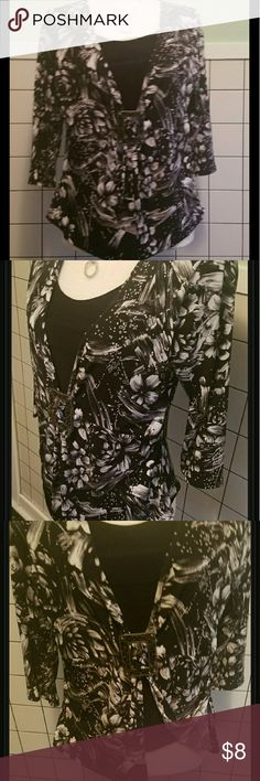 Nice black and white blouse with floral design Black & white floral design blouse with 3/4 lengh sleeves, black liner & decorative buckle Necklace not included  94% polyester  6% spandex Ashley Jill Tops Blouses