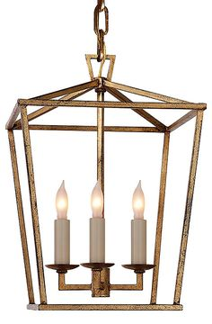 This iron lantern finished in gold adds an angular beauty to any room. Hardwired.