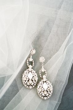 Earrings by MariaElenaHeadpieces.com -- See the wedding on SMP, here: http://www.StyleMePretty.com/2014/05/28/romantic-glamour-in-miami/ Photography: KTMerry.com -repinned from http://L2weddingphotography.com   #weddingphotographychecklist