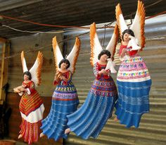 """Terracota angels painted in beautiful colours. Only in Guatemala. May this Christmas be filled with music"""" Flickr - Photo Sharing!"""