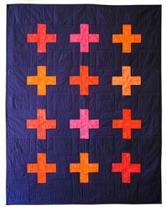 Navy and orange plus pattern quilt from Carson Converse Studio