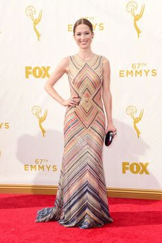 Ellie Kemper in a Naeem Khan dress and Swarovski clutch at the 2015 Emmys. See what all the stars wore to the ceremony.