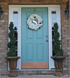 Custom blue painted front door, paint is a color match to Annie Sloans Duck Egg. Aged Copper sprayed door hardware. (love the wreath)