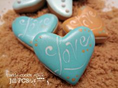 Jill FCS...wet-on-wet, dip scribe tool in icing & swirl lettering on.