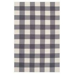 Flatweave wool rug with a ivory an gray plaid motif. Handmade in India.  Product: RugConstruction Material: ViscoseColor: Winter WhiteFeatures:  Hand-wovenReversibleIndia Dimensions: 8' x 11'Note: Please be aware that actual colors may vary from those shown on your screen. Accent rugs may also not show the entire pattern that the corresponding area rugs have.Cleaning and Care: Vacuum regularly with non-beater attachment. Blot stains immediately. Test cleaning products in discreet area. Dry…