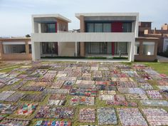 300  boucherouite rag rugs on a green ready to welcome a wedding party !