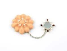 Fleshgem Brooch #1  by Jill Baker Gower - Silicone rubber, argentium silver, pearls, garnets, mirror, rare earth magnets - 2013