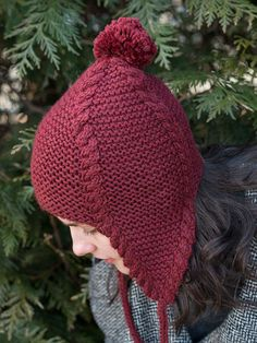 The classic combination of garter stitch and cables makes for a fun and functional earflap hat. Knit the earflaps first, then join in the round to the crown—and don't forget to top off this hat with a pom-pom!