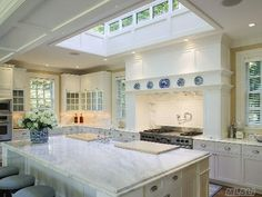 Remodeling Kitchen Lighting Skylight in kitchen! great idea to help reduce power usage since you would have the natural light during the day. New York Homes, New Homes, New Kitchen, Kitchen Ideas, Kitchen Island, Kitchen Inspiration, Beautiful Kitchens, My Dream Home, Home Kitchens