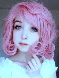 This girl looks like a doll or drawing. She's so perfectly cute