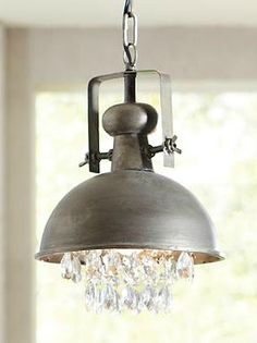 Industrial meets glamour in the Metal and Crystal Pendant; a contemporary way to shine a light on any room.