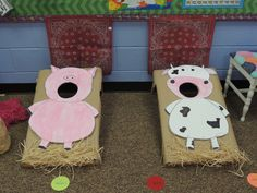 Feed the cow and pig bean bag toss game for farm theme party in the classroom.