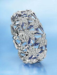 "A Diamond, Sapphire and Emerald ""En Vole"" Bracelet, by Cartier"