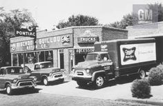Here's a classic small town Pontiac / GMC dual dealership from the 1950s. Traveling through small towns even today, you will find many unusual dual dealerships are still bringing GM products to their customers. Assembly Line, Old Cars, Small Towns, Classic Cars, Racing, Trucks, 1950s, Car Dealers