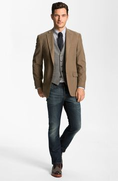 Professors's Clothing: He wears a crisp light brown blazer on top for a professional studios look.