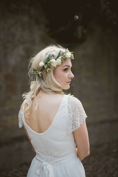 Bride wears a white flower crown | Photography by http://tomravenshear.com/