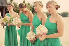 Love this shade of green, the twisted buns and the pale pink and white bouquets for these emotional bridesmaids.    Destination wedding in Malaysia http://su.pr/2Z56LL photo by Ruby Yeo