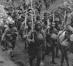 7 January 1942 - Siege of the Bataan Peninsula begins - Japanese sodiers marching to Bataan.