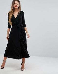 A black wrap midi dress is good to have in your arsenal.