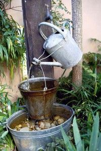 Watering water feature - had something very similar for several years - changed the flower bed and have not put it back.