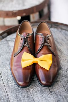 Classic groom accessories - brown shoes with bright yellow bow tie {Rad Red Creative}