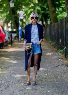 Street style points to the trend of dressing up casual denim shorts with a statement bag. A single, amazing accessory can upgrade any casual look. Check out these different ways to pair denim and a statement purse, and get some summer style inspiration.