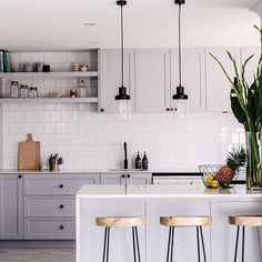 Inspired by the amazing simplicity of this kitchen space! Filing it under future kitchen... gorgeous dove grey cabinets