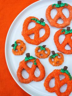 Chocolate Covered Pumpkin Pretzels - Dip pretzels in orange candy melts and sprinkles or sanding sugar; then pipe on melted chocolate leaves and stems.