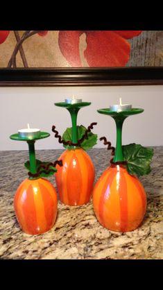 Wine Glasses Painted To Look Like Pumpkins.