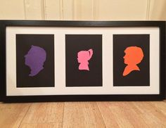 Custom Bespoke Silhouette Family Portrait in a Black Triple Frame Cut out on Multi-coloured Card by SilhouettesUK