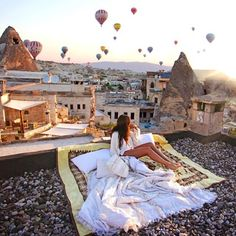 Watch the sunrise and hot air balloons above the rooftops. #wanderlust