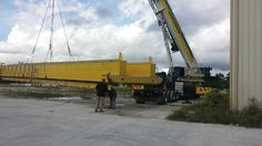 AC200-1 removing 50K pound, 80' long overhead crane in Fort Lauderdale