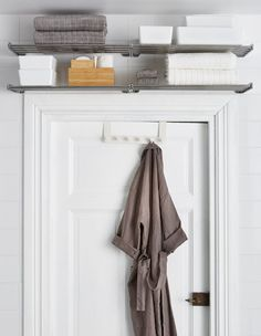 Have you ever noticed the wall space above your bathroom door? That's prime real estate right there! Follow IKEA's lead and install vintage-style shelving units right above it to store your towels and odds and ends.