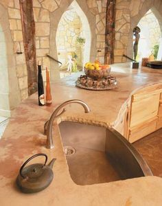 This feel for the kitchen/bathroom, its ruggedness of wood and stone, is exactly the kind of feel we love - Mel