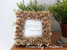 Decorate a photo frame with paper roses from old book pages