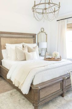 way day bedroom sale / neutral guest bedroom with wooden headboard, neutral throw pillows, wooden beaded chandelier, and mirror. Neutral Bedroom Decor, Home Decor Bedroom, Neutral Pillows, Neutral Bedding, Neutral Bedrooms, Cozy White Bedroom, Bedroom Furniture, Wooden Bedroom, Diy Bedroom