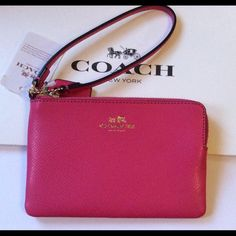 Authentic Coach Wristlet IM/Dahlia NWT Authentic Coach Wristlet ~ Pink/Gold-Tone  Crossgrain leather Inside multifunction pocket Zip closure, fabric lining Wrist strap attached 6 1/4 (L) x 4 (H)  New With Tags,  Gift Box Included   No Trades No Holds  Coach Bags Clutches & Wristlets