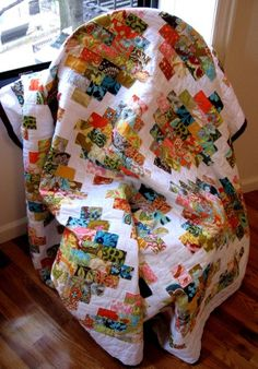 """I LOVE this quilt and it doesn't look TOO hard....? 2"""" x 3"""" cut rectangles, sewn to 2.5"""" x 1.5"""" blocks in a sort of """"running diagonal brick-layed"""" pattern...  VERY PRETTY! Oh, and all Amy Butler patterned fabrics from a few different collections, too!!"""