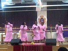 """Holding On""..holding on to Jesus,& don't let go of your faith!! Sing ladies!! Alright sister,love those moves!! Hold on!!  Put your hands together people!! Sweet!"