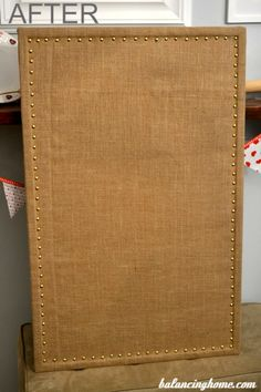 Old cork board updated with burlap and upholstery tacks. Includes tutorial.