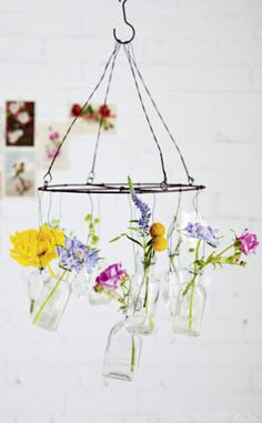 39.00 SALE PRICE! Make your own magnificent hanging flower arrangement in a multitude of sweet vintage vases that hang from the wires of this chandelier. You...